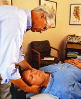 image of a doctor examining a patient